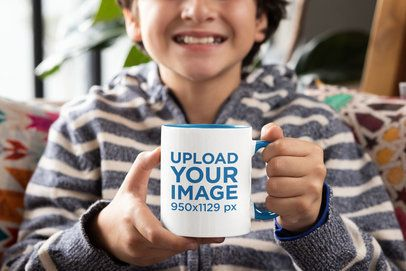 Mockup Featuring a Happy Boy Holding an 11 oz Colored Rim Mug 33165
