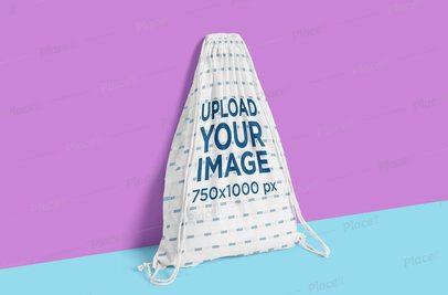 Mockup of a Sublimated Drawstring Bag Featuring a Bicolor Background 3501-el1