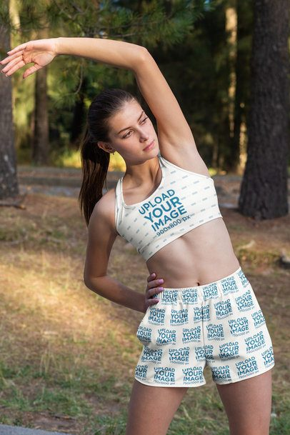Sports Bra Mockup Featuring a Woman with Shorts Stretching 33085