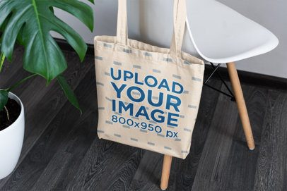 Sublimated Tote Bag Mockup Featuring a Modern Chair and a Plant 3149-el1