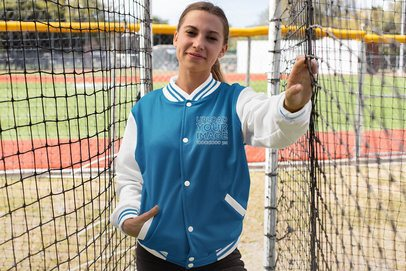 Mockup of a Smiling Woman Wearing a Varsity Jacket 33217