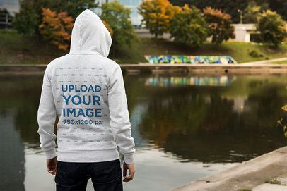 Back-View Mockup of a Man Wearing a Hoodie by a Lake 3567-el1