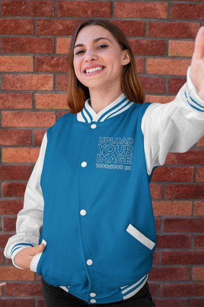 Selfie Mockup Featuring a Joyful Woman Wearing a College Jacket 33211