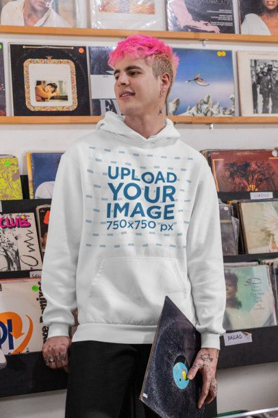 Hoodie Mockup of a Man with a Pink Hair at a Music Store 33318