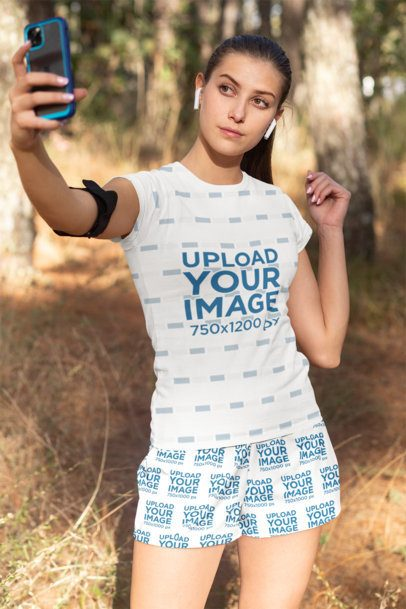 T-Shirt and Shorts Mockup of a Woman Taking a Selfie 33080
