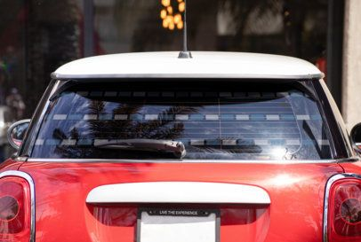 Mockup of a Rear Window Decal Placed on a Subcompact Car 33254