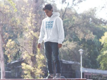Pullover Hoodie Mockup of a Guy Standing in a Park and Looking Down a12495