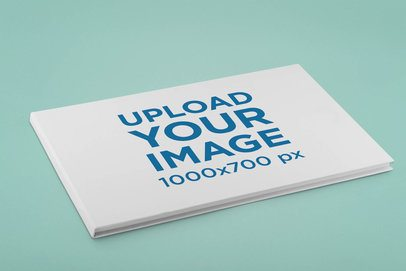 Mockup Featuring a Hard Cover Horizontal Book on a Flat Surface 33396