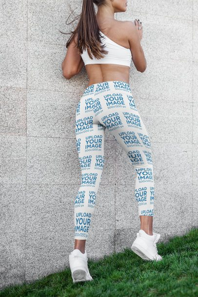 Mockup of a Fit Woman with Leggings Posing by a Concrete Wall 3659-el1