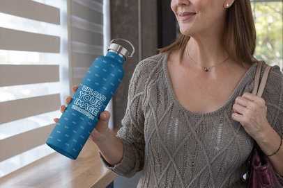 Cropped Face Mockup of a Middle-Aged Woman Holding an Aluminum Bottle 33490