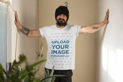 Mockup of a Tattooed Man Wearing a T-Shirt Indoors 32833