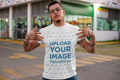 T-Shirt Mockup of a Tattooed Man Showing Swag on the Street 32822