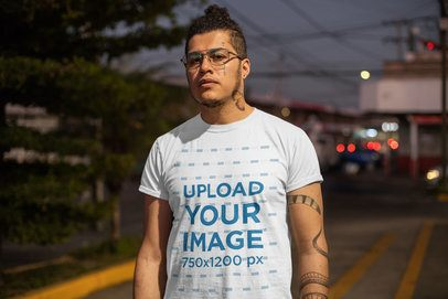 T-Shirt Mockup of a Man on the Street at Night 32823