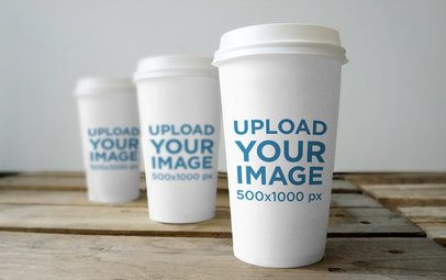 Mockup Featuring Three Coffee Cups Placed on a Rustic Wooden Table 3794-el1