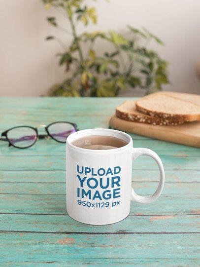 Sticker Mockup Featuring an 11 oz Coffee Mug on a Green Wooden Desk 33619