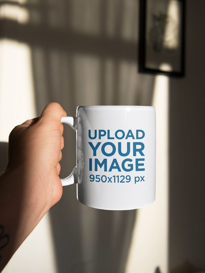Sticker Mockup Featuring a Man Holding a Coffee Mug 33617