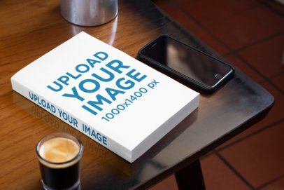 Mockup of a Book on a Table with a Phone and a Coffee 33904