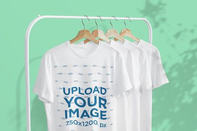 Mockup of Four T-Shirts Hanging From a Metal Clothing Rack 3731-el1