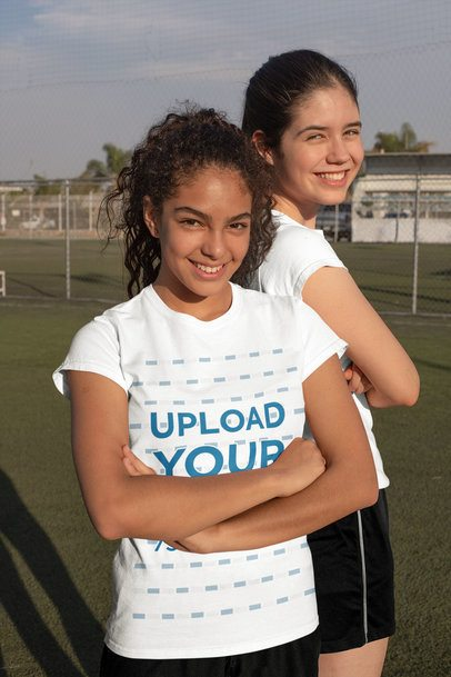T-Shirt Mockup of Two Teenagers Posing at a Soccer Field 33558