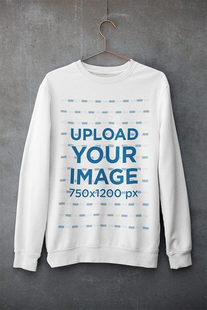 Mockup of a Customizable Crewneck Sweatshirt Hanging Against a Concrete Wall 33997