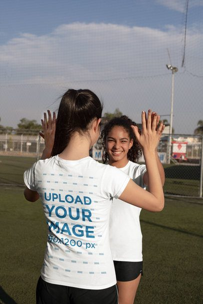 T-Shirt Mockup of a Girl Celebrating with Her Soccer Teammate 33556
