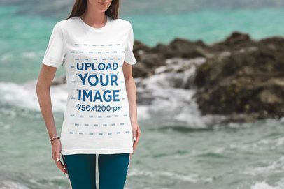 T-Shirt Mockup Featuring a Woman and the Sea in the Background 3328-el1
