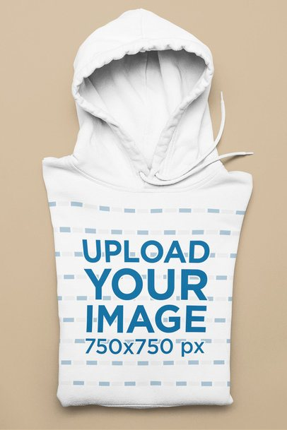 Mockup of a Folded Pullover Hoodie Against a Solid Surface 33898