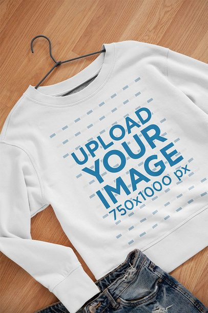 Mockup of a Sweatshirt on a Hanger over a Wooden Surface 33999
