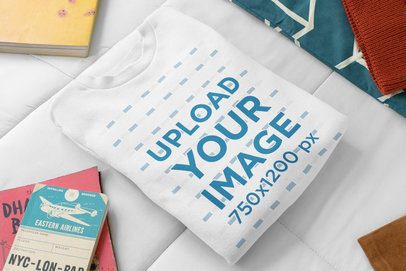 Mockup of a Kids' Sweatshirt on a Bed with Notebooks 33761