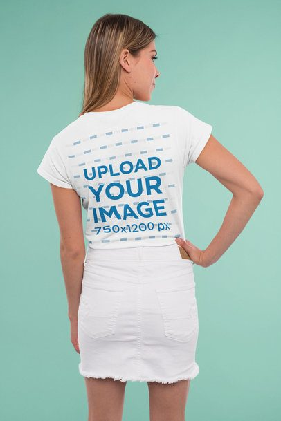 Back-View Mockup of a Young Woman Wearing a T-Shirt in a Studio 31957