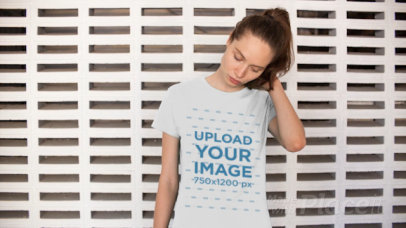 T-Shirt Video of a Woman Standing in Front of a Patterned Wall 12915