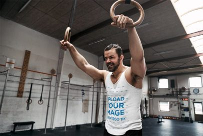 Tank Top Mockup Featuring a Strong Man Doing a Gymnastic Rings Workout 34060-r-el2