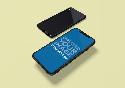Mockup Featuring the Front and Back Sides of an iPhone X Over a Colored Surface 2005-el1