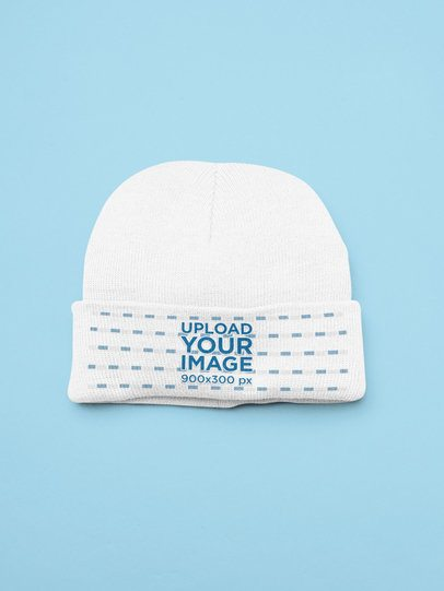 Mockup of a Beanie Flat Laid on a Customizable Background 25518