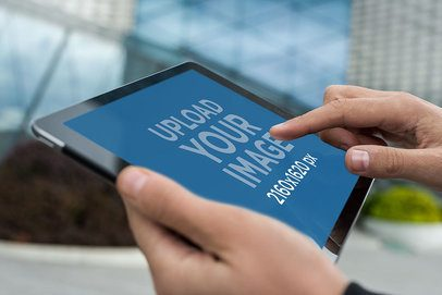 Mockup of a Man Manipulating an iPad in Landscape Position 2048-el1