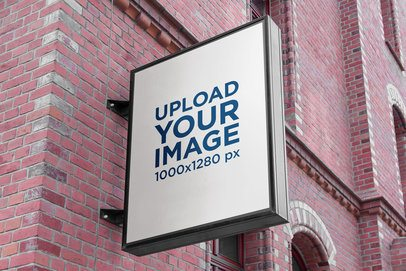 Mockup of a Vertical Sign Placed on a Brick-Wall Facade 4095-el1