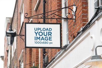 Mockup of an Outdoor Store Sign Placed on a Brick Facade 4120-el1