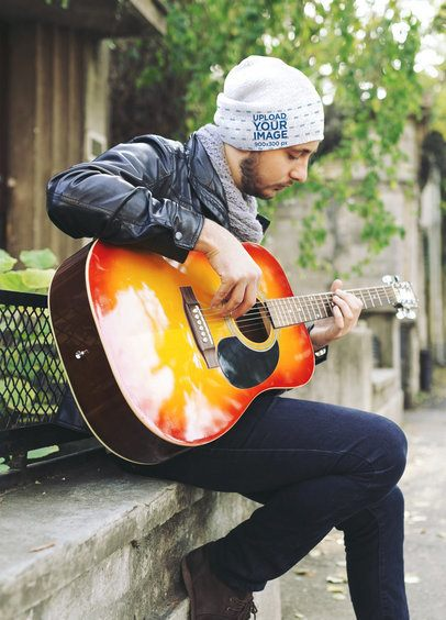 Beanie Mockup Featuring a Man Playing the Guitar Outside 35143-r-el2