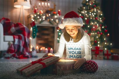 Long Sleeve Tee Mockup Featuring a Smiling Girl Opening a Christmas Present 34660-r-el2