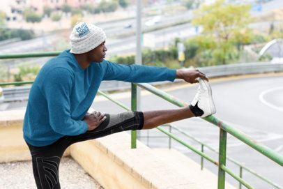 Beanie Mockup Featuring a Man Stretching 34696-r-el2