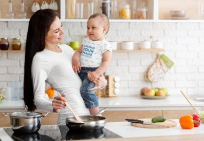 Onesie Mockup of a Mom Holding His Baby While Cooking in Her Kitchen 34625-r-el2
