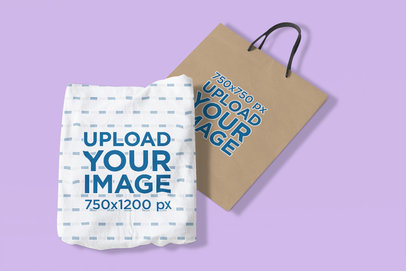 Mockup Featuring a Sublimated T-Shirt and a Paper Bag Lying on a Colored Surface 4310-el1
