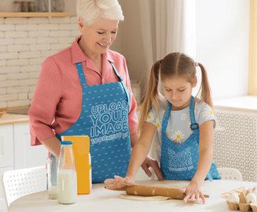 Apron Mockup Featuring a Grandma and Her Granddaughter Baking 34701-r-el2