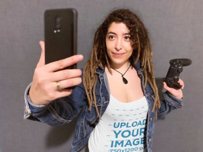 Tank Top Mockup Featuring a Gamer Woman Taking a Selfie 36767