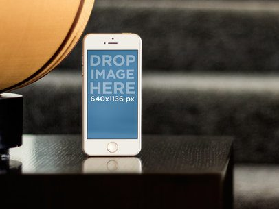Apple iPhone 5s Gold Portrait Stand Out On Coffee Table