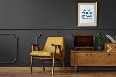 Mockup of an Art Print with a Golden Frame Hanging in a Modern Living Room 36957-r-el2