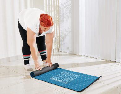 Mockup of a Woman Rolling Up Her Yoga Mat 37056-r-el2