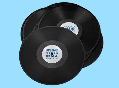 Mockup Featuring Several Vinyl Records Placed on a Plain Color Surface 37198-r-el2