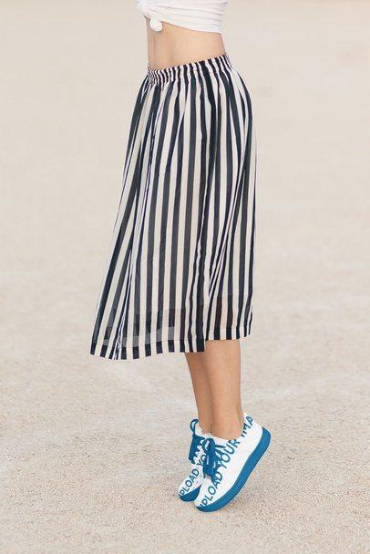 Mockup of a Woman Wearing a Pair of Sneakers 36538-r-el2