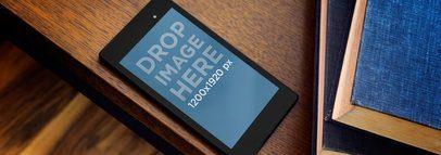 Google Nexus7 Black Portrait Next To Books Wide